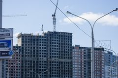 Erection of Modern building. Erection of a monolithic residential building stock photo