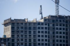 Erection of Modern building. Erection of a monolithic residential building royalty free stock image