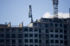 Erection of Modern building. Erection of a monolithic residential building stock photos