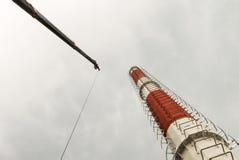 Erection progress of telecommunication tower or monopole Stock Photos