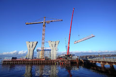 Erection of the towers crane, connecting outer jib to inner jib Stock Image
