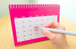 Ereignisdatum in einem Kalender Stockfotos
