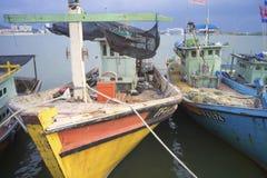 ERENGGANU, MALAYSIA - APRIL 20, 2015 - Fishermen boat parked near Seberang Takir beach, Terengganu, Malaysia at APRIL 20, 2015. Stock Photo