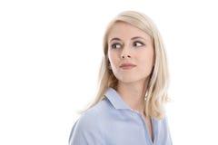 Erfüllte lokalisierte junge Geschäftsfrau, die seitlich schaut Stockfotografie