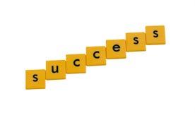Erfolg geschrieben in Zeichenfliesen Stockfotos