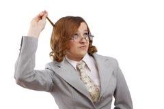 Erfolgreiche Geschäftsfrau denkt an etwas. lizenzfreie stockfotografie