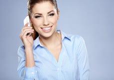 Erfolgreiche Geschäftsfrau mit Handy. Stockbild