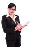 Erfolgreiche Geschäftsfrau mit roter Tagesordnung Lizenzfreie Stockbilder