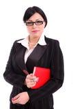Erfolgreiche Geschäftsfrau mit Tagesordnung und Feder Stockbilder