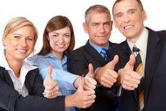 Erfolgreiche Geschäftsgruppedaumen oben Stockbild