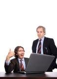 Erfolgreiche Geschäftsmänner mit Laptop Stockfoto