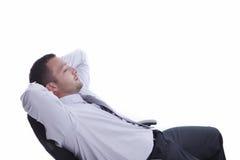 Erfolgreicher entspannender Geschäftsmann Stockfoto