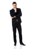 Erfolgreicher Geschäftsmann mit dem Finger unter Kinn Stockbild