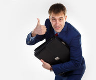 Erfolgreicher Geschäftsmann mit einem Aktenkoffer Lizenzfreie Stockbilder