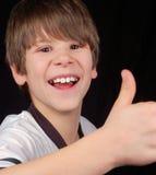 Erfolgreicher glücklicher und stolzer Junge Stockfotografie