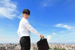 Erfolgreicher hübscher Geschäftsmann Stockfoto