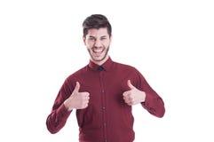 Erfolgreicher junger Mann, der sein Gewinnen feiert Stockfoto