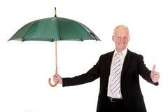 Erfolgreicher lächelnder Geschäftsmann Stockfoto