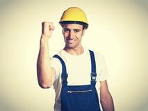 Erfolgreicher lateinischer Bauarbeiter im Retro- Blick der Weinlese Lizenzfreies Stockbild