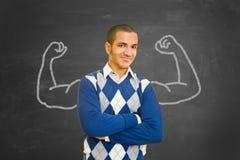 Erfolgreicher Student mit den Muskeln der Kreide als Motivationskonzept lizenzfreie stockbilder