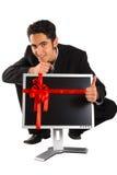 Erfolgreiches Geschäftsmannkaufüberwachungsgerät. Stockbild