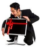Erfolgreiches Geschäftsmannkaufüberwachungsgerät Lizenzfreie Stockfotografie