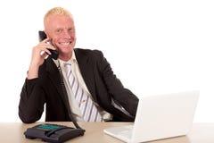 Erfolgreiches Geschäftsmanntelefon Stockbild