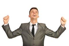 Erfolgreiches Geschäftsmannzujubeln Stockbilder