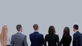 Erfolgreiches Geschäftsteam, das aufwärts Rückseite der Stellung schaut Lizenzfreie Stockbilder