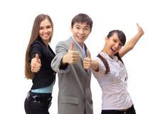 Erfolgreiches Geschäftsteam mit den Daumen Stockbild