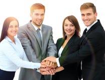 Erfolgreiches Geschäftsteam mit faltete seine Hände zusammen Lizenzfreie Stockfotografie