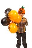 Erfolgreiches Kind mit Halloween-Ballonen Lizenzfreies Stockbild