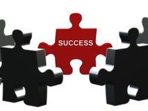 Erfolgs-Puzzlespielstück Stockbilder