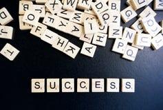 Erfolgswort auf hölzernem Block Stockfotos