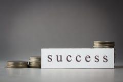 Erfolg und Münzen Stockfotografie
