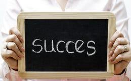 Erfolgswort geschrieben auf Tafel/chalckboard Stockfotografie