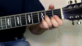 Erformer playing on the acoustic guitar. stock footage