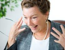 Erfreute und überraschte Executivgeschäftsfrau Stockfotos