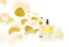 Erfume bottle spraying rose petals Royalty Free Stock Image