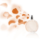 Erfume bottle spraying rose petals Royalty Free Stock Photography