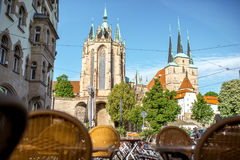 Erfurt city in Germany. View on the main square with Mary Domberg cathedral and cafe terrace at the old town of Erfurt city, Germany Stock Image