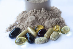 Ergänzungen - Vitaminmineralien, Schokoladenproteinpulver Stockbild