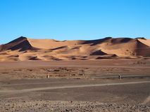 Erg Chebbi dunes in Morocco. ERG CHEBBI dunes range near MERZOUGA city with landscape of sandy desert formations in southeastern MOROCCO near border with Stock Photography