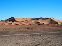Erg Chebbi dunes in Morocco. ERG CHEBBI dunes range near MERZOUGA city with landscape of sandy desert formations in southeastern MOROCCO near border with Stock Photo