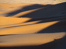 Erg Chebbi dunes in Morocco. ERG CHEBBI dunes range near MERZOUGA city with landscape of sandy desert formations in southeastern MOROCCO near border with Royalty Free Stock Images