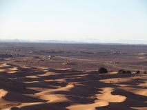 Erg Chebbi dunes in Morocco. ERG CHEBBI dunes range near MERZOUGA city with landscape of sandy desert formations in southeastern MOROCCO near border with Royalty Free Stock Image