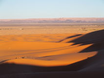 Erg Chebbi dunes in Morocco. ERG CHEBBI dunes range near MERZOUGA city with landscape of sandy desert formations in southeastern MOROCCO near border with Stock Photos