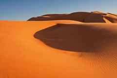 Erg Chebbi sand dunes. On sunrise in the Sahara Desert near Hassi Labiad and Merzouga, Morocco. Algeria is located 20 km from here Royalty Free Stock Photo