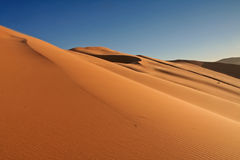 Erg Chebbi sand dunes. In the Sahara Desert near Hassi Labiad and Merzouga, Morocco. Algeria is located 20 km from here Stock Photography