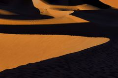 The Erg Chegaga dunes, Morocco. The dunes of Erg Chegaga at sunset. Erg Chegaga or Chigaga is one of two major Saharan ergs of the Sahara in Morocco. It is the Royalty Free Stock Images